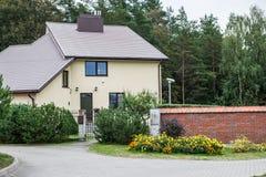 House near forest Stock Photos