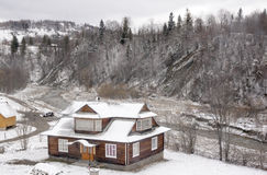 House near mountain river. Stock Photography