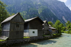 House near the river with the alps view Stock Photos