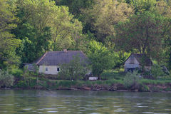 House near the river Stock Photos