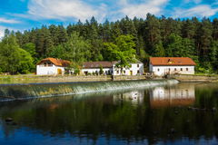 House near river. In Czech Republic Stock Image