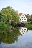 House near river Stock Photos
