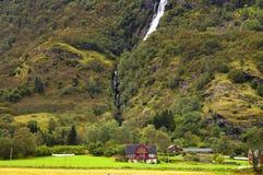 House near the waterfall. Stock Photos