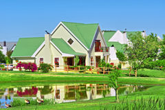 House next to lake and lawn royalty free stock images