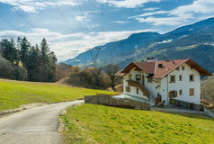 House next to the pasture on mountains background, Royalty Free Stock Photo