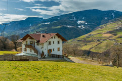 House next to the pasture on mountains background, Stock Photo