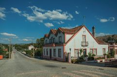 House next to a road passing through countryside. Pretty two-story house next to a road passing through countryside landscape, in a sunny day at Lageosa do royalty free stock image