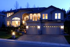 House at Night. Street View of a New large American house stock image