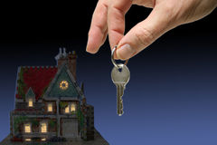 House at night. Home at night with hand and key Stock Photo