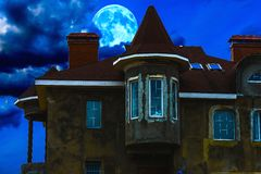 House night and the moon. House with a tower tube night against the sky and a large moon Stock Photos