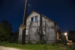 House in the night scenery, light from the street. Village stock photo
