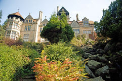 A house in northumberland. The house and garden on a high cliff at cragside in england in northumberland Royalty Free Stock Photography
