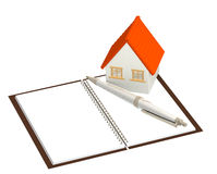 House and notebook Royalty Free Stock Photography