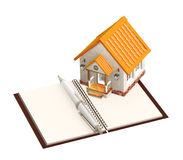 House and notebook Royalty Free Stock Photos