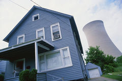 House with nuclear cooling tower Stock Photo