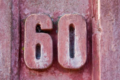 House number 60. On an old wall Royalty Free Stock Images
