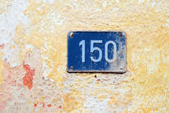 House number 150. House address plate number (150) hanging on wall Stock Photography