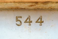 House number 544. Brass house number five hundred and forty four Royalty Free Stock Photos
