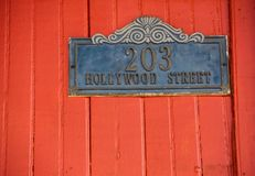 House Number. Bright red door with a House Number on a street in Corinto, Nicaragua royalty free stock photography