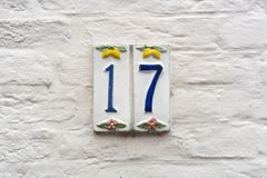 House number 17. Ceramic house number seventeen 17 Royalty Free Stock Image