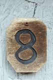 House number eight. Decorative piece of wood used as houseletter number eight on a building Royalty Free Stock Photo