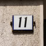 House number eleven 11. On a plastered wall Royalty Free Stock Image