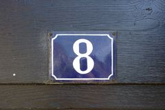House number 8. Enameled house number eight 8 Royalty Free Stock Photos