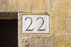 House number 22 engraved in stone. House number twenty two 22 ngraved in stone Stock Images