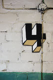 House number four an artistic style. Cardboard number 4 on an old brick wall in an art style stock photo