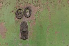 House number on green door royalty free stock photography