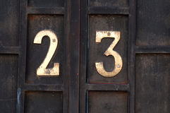 House number 23. On metal door Stock Photography
