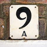 House number 9. House number nine 9 on a brick wall Stock Photography