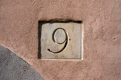 House number 9 engraved in stone. House number nine 9 engraved in stone Stock Photos