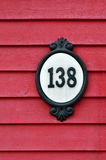 House number. Old street number on wooden house front Royalty Free Stock Photography