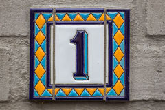 House number one . Blue lettering on a white plate Stock Image