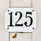 House number 125. House number one hundred and twenty five 125 Royalty Free Stock Photography