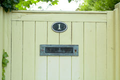 House number one sign and letterbox on gate Royalty Free Stock Photo