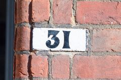 House number 31 painted sign Royalty Free Stock Image