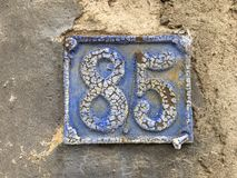 85 house number plate on wall Royalty Free Stock Image