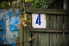 House number plate on a wooden fence. Stock Photography