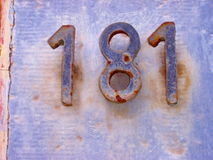 House number 181. Rusted metal numbers on old building royalty free stock image