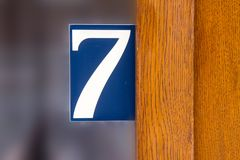 House number seven 7. On a glass window Royalty Free Stock Images