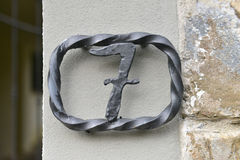 House number seven. Twisted metal house number seven Royalty Free Stock Image