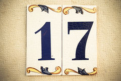 House number seventeen on the traditional Portuguese glazed tile Royalty Free Stock Photography