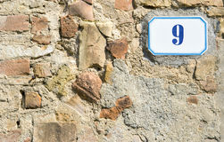 House number 9 sign. With bricks and stones background Stock Photography