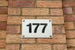 House number 177 sign fixed to wall. Of building Stock Photos