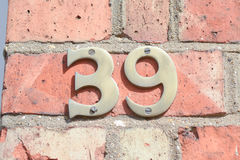House number 39 sign on wall. To property Stock Photo