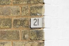 House number 21 sign on wall Stock Photos