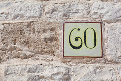 House number sixty as a square tile Royalty Free Stock Photos