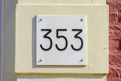 House number 353. House number thee hundred and fifty three 353 Stock Image